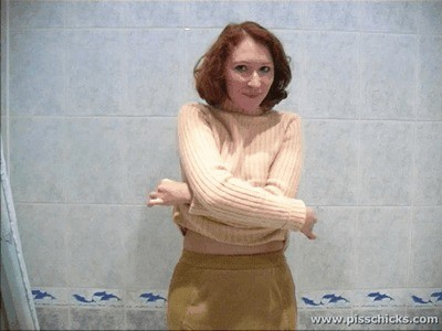Red Haired Girl Strips In The Bathtub