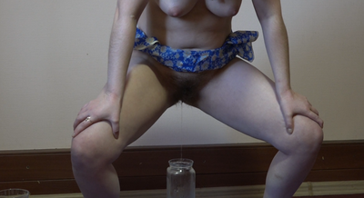 Naked Female With Hairy By A Pussy Pissing In The Decanter