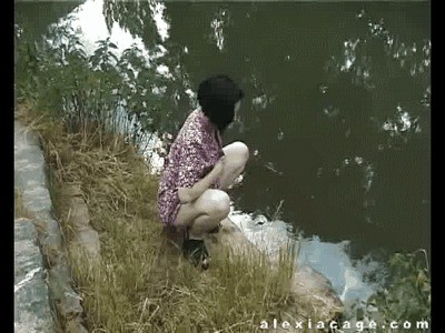 Kinky Alexia Cage Pissing On The River Side